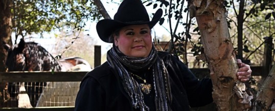Anita standing outside at ranch