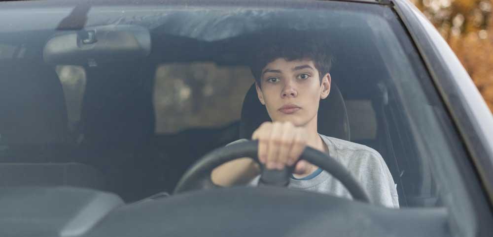teen boy behind the wheel