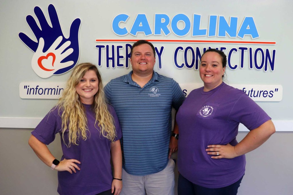 Carolina Therapy Connection staff in front of sign