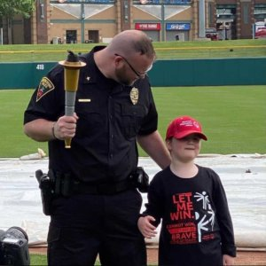 Greensburg Police Officer with child