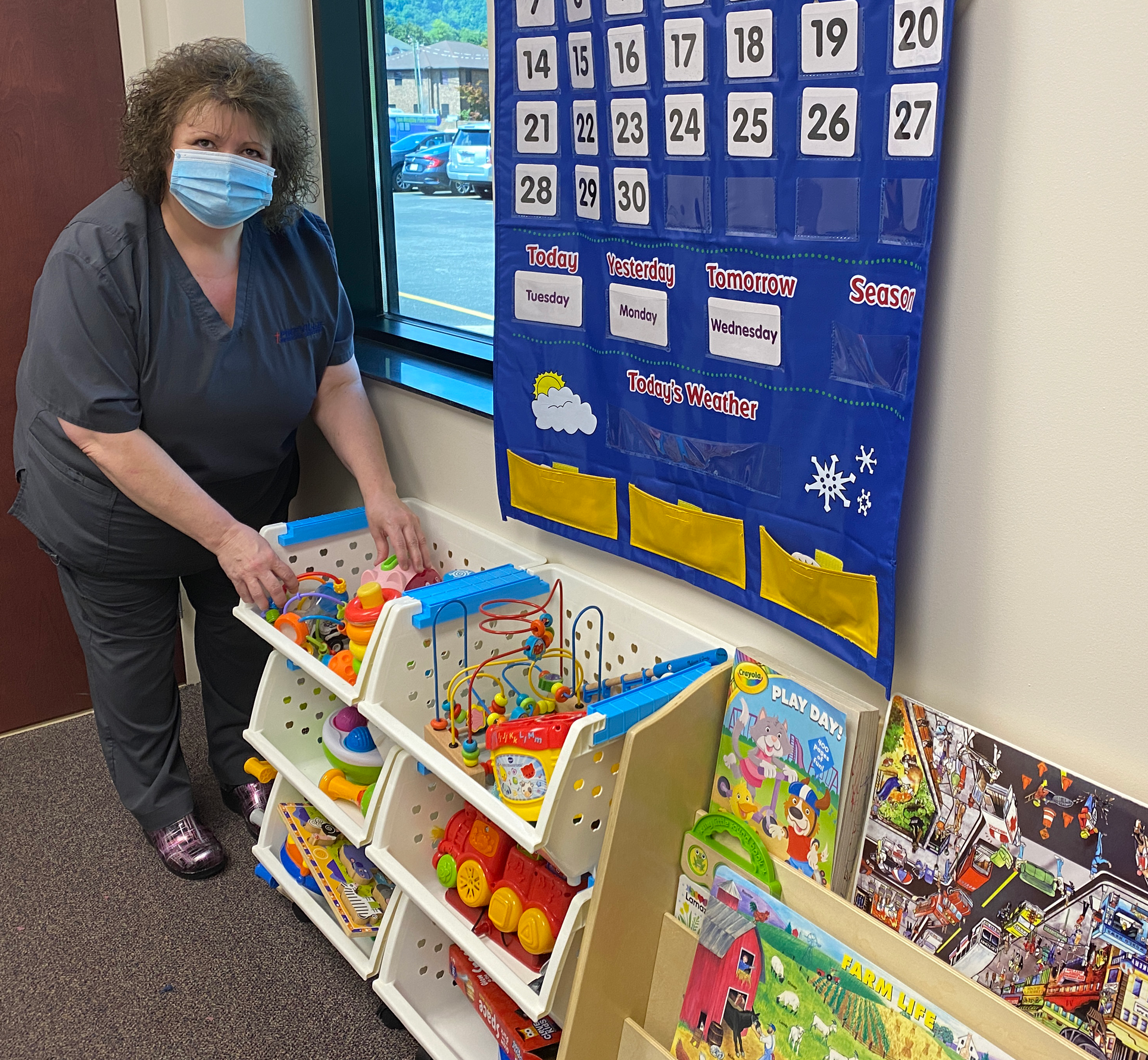 Staff Member setting up room with toys and games