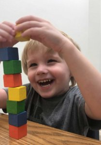 boy playing with blocks at Cutting Edge Therapy