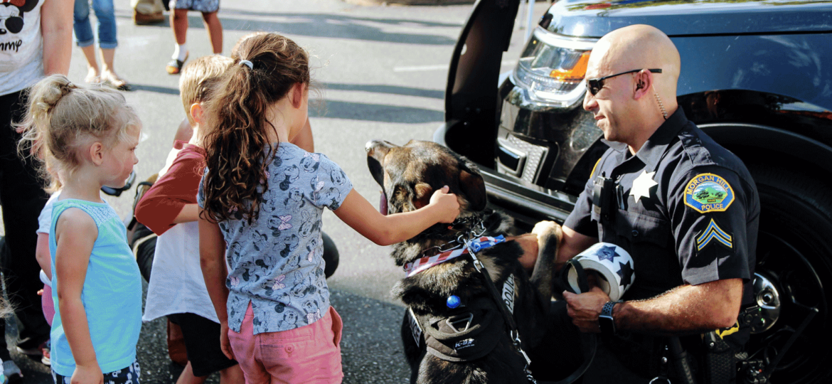Morgan Hill Police officer with k-9 and kids