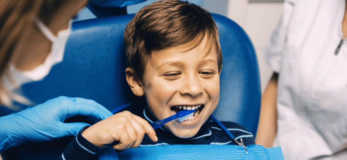 Young boy getting teeth cleaned