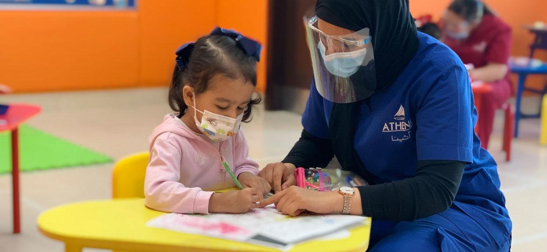 Athena Center teacher helping student