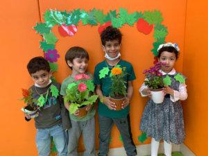 Athena Center student holding plants