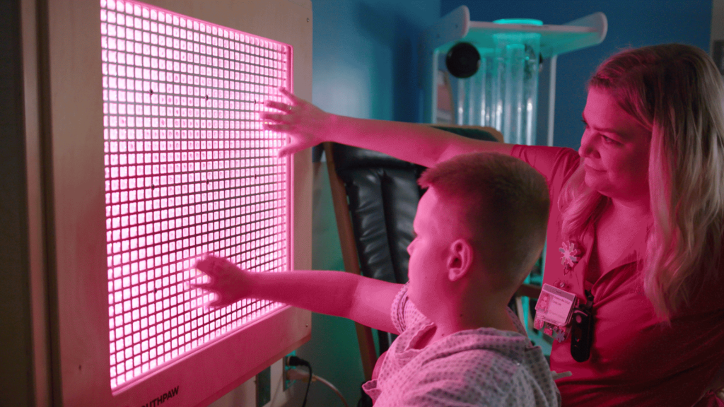 Dayton Children's Hospital Sensory room young patient and staff using light board